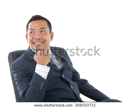 Good looking mature Asian Indonesian business man with business suit looking at side, isolated on white background.  - stock photo