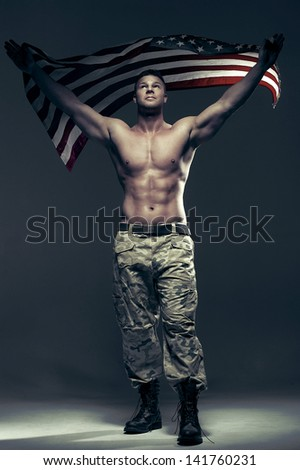 Good looking men with flag - stock photo