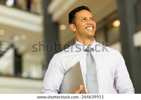 good looking middle aged entrepreneur in office building - stock photo