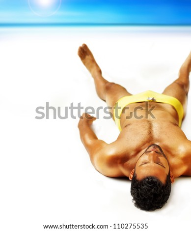 Good looking muscular young man lying outside in sun - stock photo
