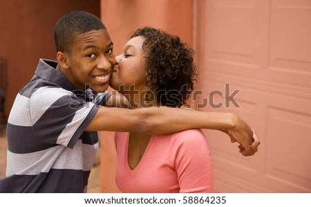 Good-looking single-parent mom and son with copy space - stock photo