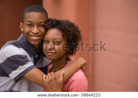 Good-looking single-parent mom and son with tilt-shift focus and copy space - stock photo