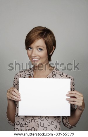 good looking woman holding a white card
