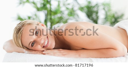 Good looking woman relaxing on a lounger in a wellness center