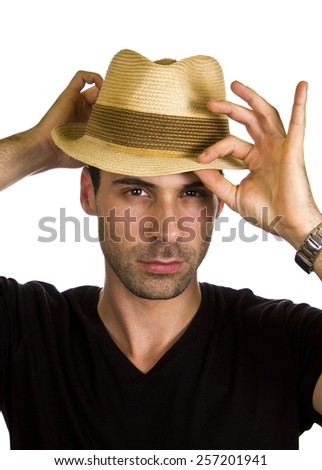 Good looking young man is wearing hat.
