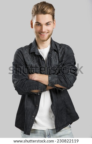 Good looking young man smiling and looking to the camera, isolated on white background - stock photo