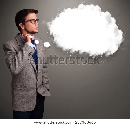 Good-looking young man thinking about cloud speech or thought bubble with copy space - stock photo