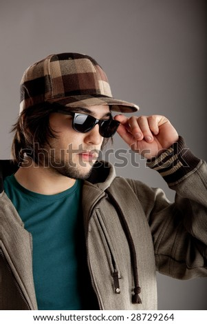 Good looking young man wearing a sunglasses - stock photo