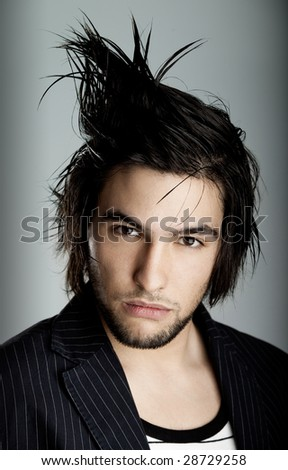 Good looking  young man with modern HairStyle - stock photo