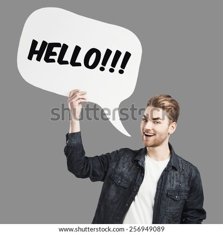 Good looking young saying Hello with a  speech balloon - stock photo