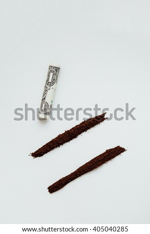 good morning, alternative drugs concept,  ground coffee like cocaine powder in two lines on a white background with Rolled Up Bill, humor and fun - stock photo