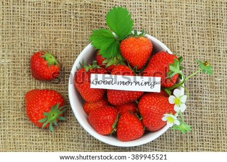 Good morning card with bowl of fresh strawberries on jute surface with copy space