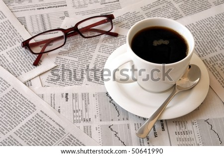 good morning coffee break with reading the newspaper - stock photo