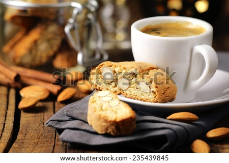 Good morning concept - breakfast frothy espresso coffee accompanied by delicious Italian almond cantuccini biscuits - stock photo