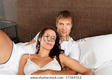 good morning - couple in bed - stock photo