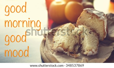 Good morning. Good mood. Freshly baked buns with raisins. Tasty bread and fruit for breakfast. Fresh pastries and fruit for breakfast in the morning. Concept - morning, sun light, fresh cakes. - stock photo