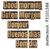 Good morning in five languages - English, German, French, Spanish and Portuguese - a collage of isolated words in vintage letterpress wood type - stock photo