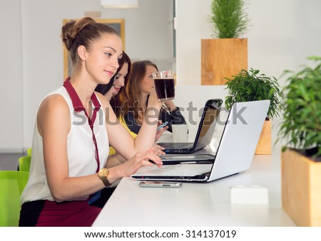 Good morning, office worker. Young business woman drinking coffee in office. Coffee break with office women colleagues sitting over cups of coffee. Coffee in the workplace. Woman and office staff. - stock photo