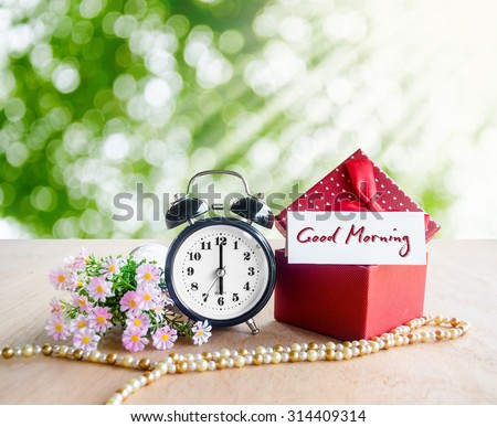 Good morning tag alarm clock gift stock photo edit now shutterstock good morning tag and alarm clock with gift box on spring background negle