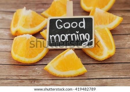Good morning. Tasty morning. Orange morning. Orange pieces on wooden background.  - stock photo