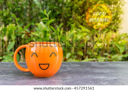 Good morning with coffee cups in orange message concept A Happy Day Front porch