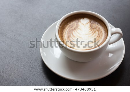 Good morning with the beautiful of a cup of latte art coffee