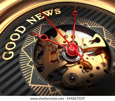 Good News on Black-Golden Watch Face with Closeup View of Watch Mechanism. - stock photo