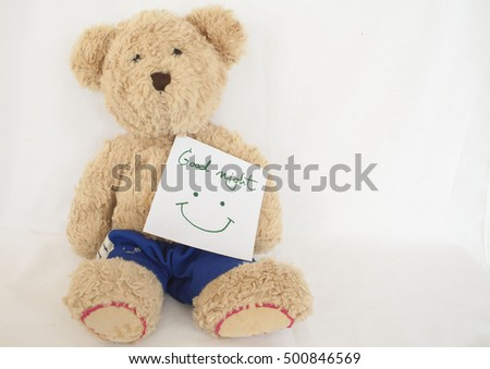 good night message card and teddy bear on background white
