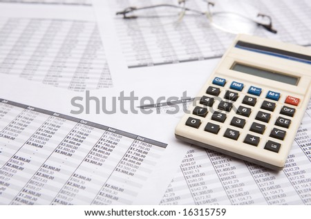 good oldcaculate on the financial sheet - stock photo