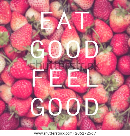 Good quote on strawberry background , Eat good feel good - stock photo