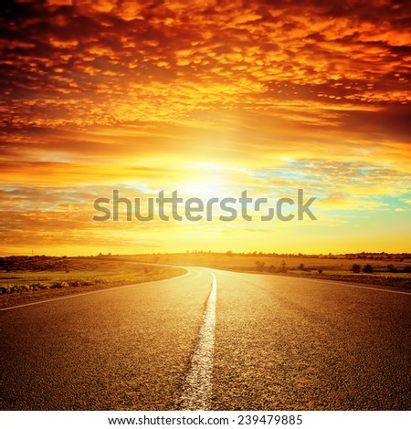 good red sunset and asphalt road to horizon - stock photo