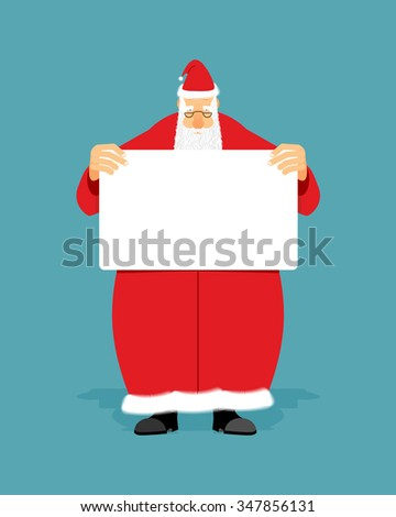 Good Santa Claus holding blank sign with space for text. Christmas man with white paper. Christmas Santa in red coat with  white banner. - stock photo