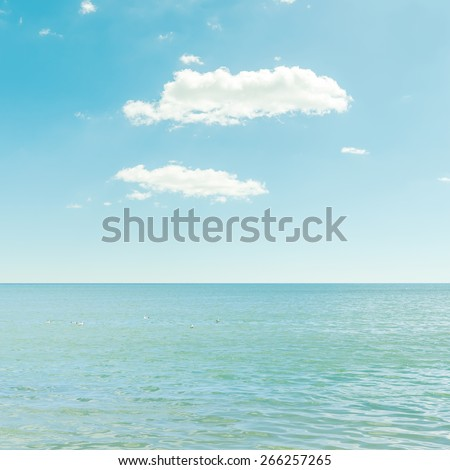 good sea and blue sky with clouds - stock photo