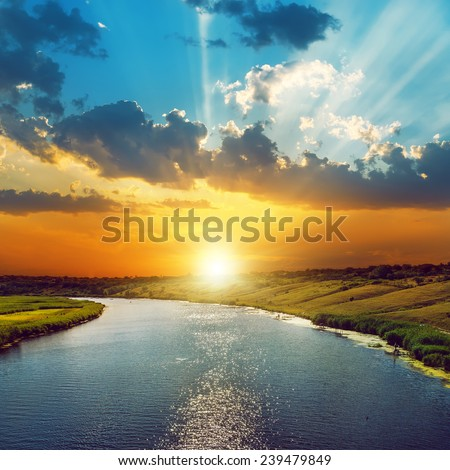 good sunset in clouds and river - stock photo