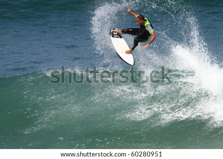 good surfer in action on a powerful wave - stock photo