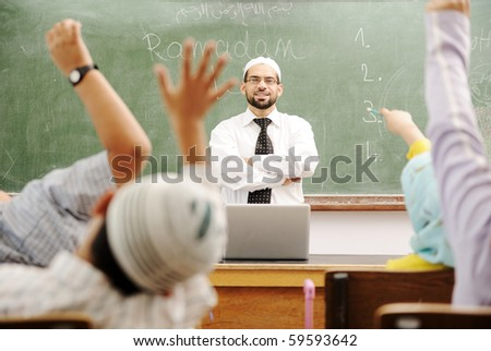Good teacher in classroom in front of the board - stock photo