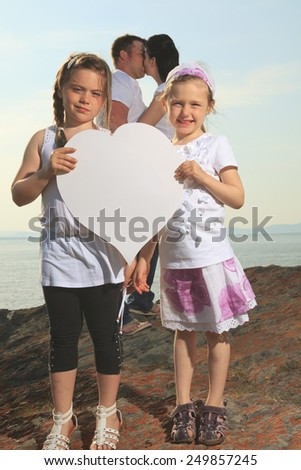good time family in front of ocean - stock photo