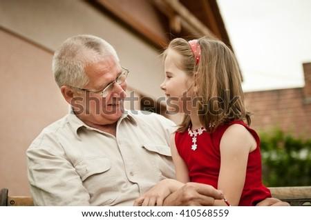 Good times - grandparent with grandchild - stock photo