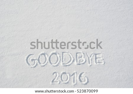 Goodbye 2016 handwritten on flat snow surface. Empty space for copy, text, lettering. Horizontal new year holiday postcard, greeting card template.