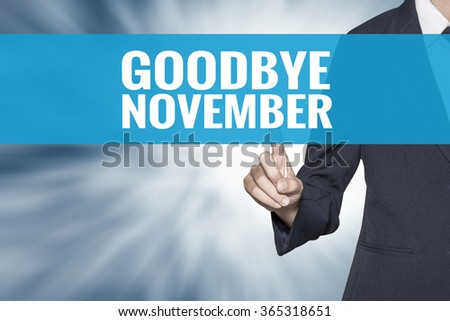 Goodbye November word on virtual screen touch by business woman cyan sky tab - stock photo