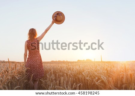 goodbye or parting background, farewell, woman waving hand in the field - stock photo