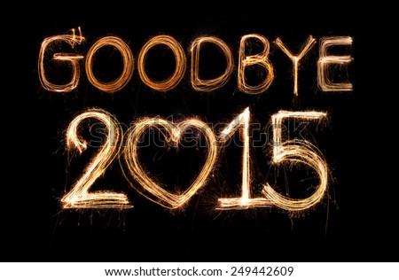 Goodbye 2015 word made from sparkler firework light - stock photo