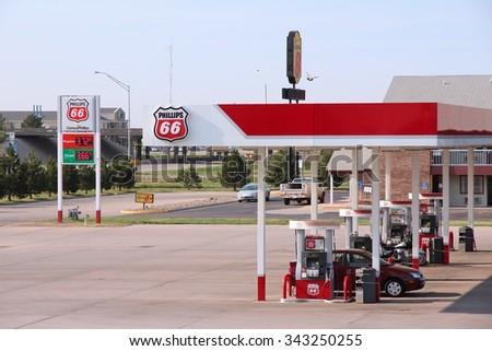 GOODLAND, KANSAS - JUNE 25, 2013: People fill their tanks at Phillips 66 gas station in Goodland, Kansas. Phillips 66 had revenue of US$ 166 billion in 2012. It employs 13,500 people. - stock photo