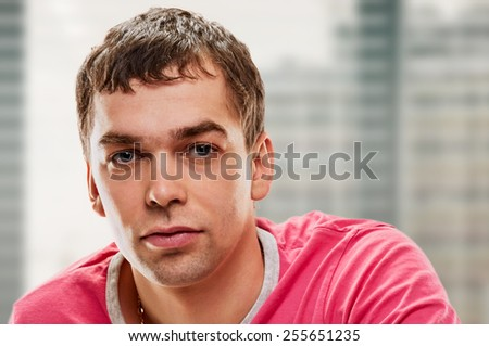 Goodlooking young man indoor on window background - stock photo