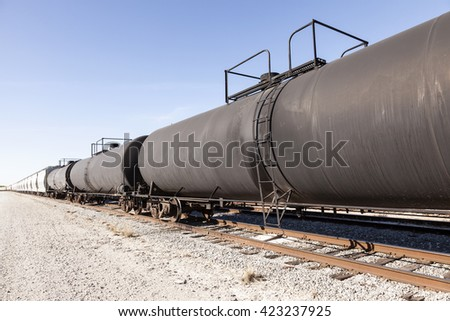 Goods and cistern wagons on the railroad