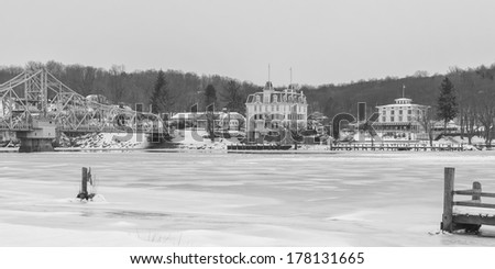Goodspeed Opera House In Winter taken from the Haddam side of the Connecticut river.   Draw-bridge and Gelston house on either side. - stock photo