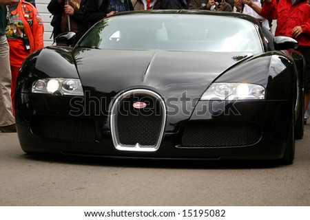 Goodwood UK, July 13, 2008: front of black Bugatti Veyron driving towards camera at Goodwood Festival of Speed - stock photo
