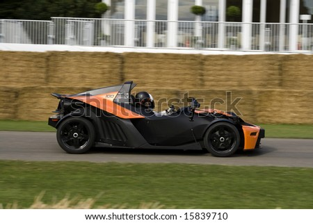 GOODWOOD, UK, JULY 13: Goodwood Festival of Speed,  black KTM X-Bow driving on track.