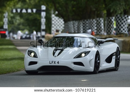 GOODWOOD, UK - JULY 1: The Koenigsegg Supercar drives up the Festival of Speed hill course at Goodwood, UK on July 1, 2012 - stock photo