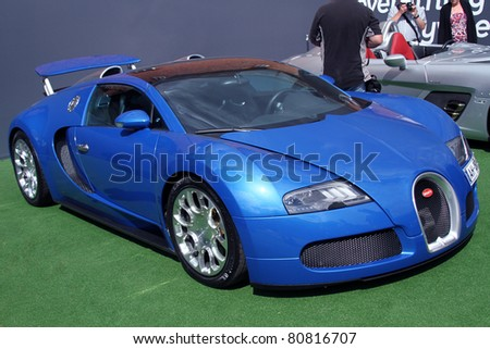 GOODWOOD, UK - JUNE 30: blue bugatti veyron on display at the annual  Goodwood Festival of Speed on June, 30 2011 in Goodwood England - stock photo
